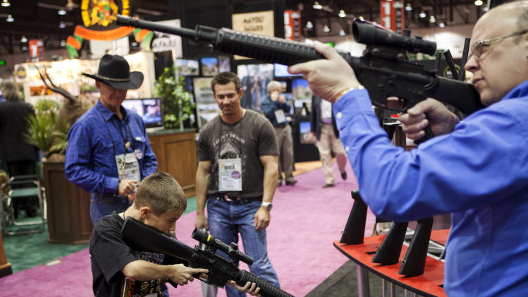 People test Trijicon rifle scopes at the Safari Club International Convention in Reno