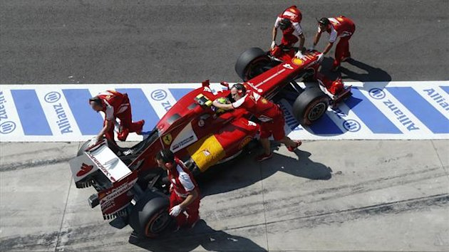 Ferrari Formula One mechanics push the car of Felipe Massa of Brazil during the second practice session of the Italian F1 Grand Prix at the Monza circuit September 6, 2013 (Reuters)