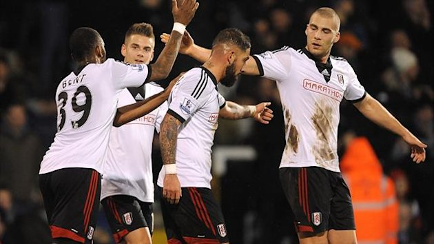 Fulham's Ashkan Dejagah (centre) celebrates scoring their second goal of the game with team-mates Darren Bent (left), Alex Kacaniklic and Pajtim Kasami (right) (PA Sport)