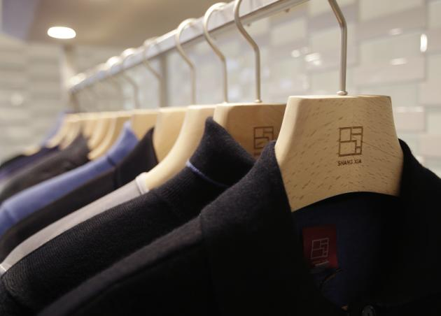 Cashmere jackets are displayed for sale in the shop of the young brand Shang Xia on its opening day in Paris