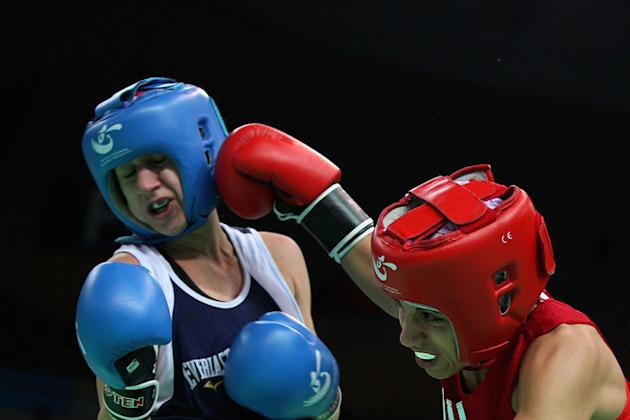 Christina Cruz (Blue) Of The United States Fights Against Shora Rezaie Jahroni (Red) Of Norway In The Women's 54kg Getty Images