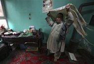 Zabulon Simintov, an Afghan Jew, prepares for prayers at his residence in Kabul November 5, 2013. REUTERS/Omar Sobhani
