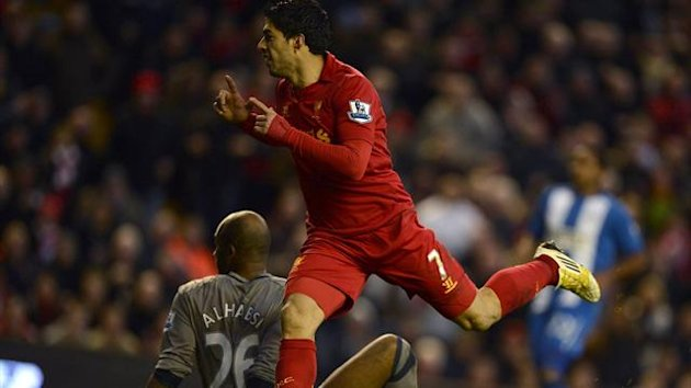Luis Suarez scores his second for Liverpool against Wigan at Anfield