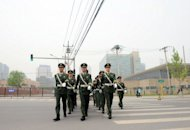 Chinese paramilitary guards march outside the US embassy in Beijing on April 30, 2012. Beijing and Washington are working on a deal to allow rights activist Chen Guangcheng to leave China for the United States with his family after he fled house arrest, a fellow activist said Tuesday