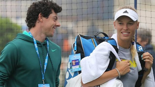 Golfer Rory McIlroy walks off the practice courts with girlfriend Caroline Wozniacki (PA Sport)