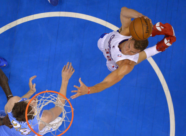 Los Angeles Clippers forward Blake Griffin, right, goes up for a dunk as Denver Nuggets forward Jan Vesely, of the Czech Republic, defends during the first half of an NBA basketball game, Tuesday, Apr