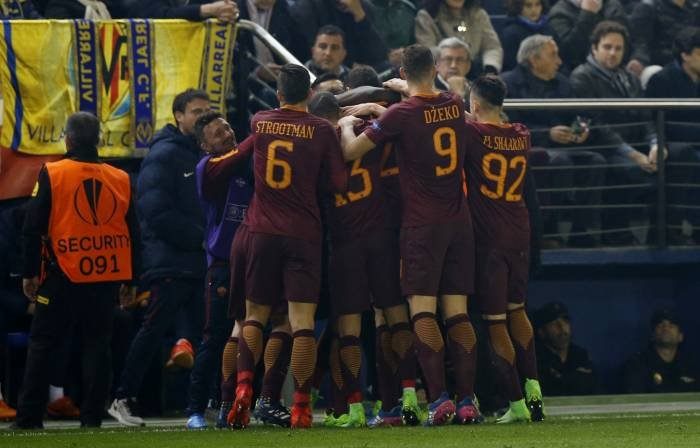 Roma celebrate another goal in their 4-0 win