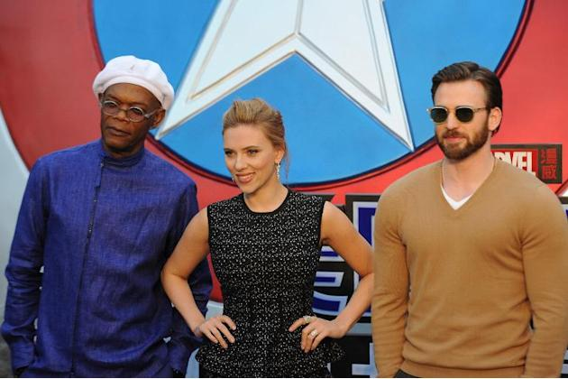 "US actors (L-R) Samuel L. Jackson, Scarlett Johansson and Chris Evans pose for photos at a press conference for the film ""Captain America: The Winter Soldier"" in Beijing on March 24, 2014"