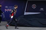 Red Bull Formula One driver Sebastian Vettel of Germany walks before unveiling the new RB10 during the official presentation of the Red Bull Formula One Team 2014 at the Jerez racetrack in southern Spain January 28, 2014. REUTERS/Marcelo del Pozo