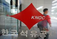 This file photo shows company's signage at head office of the Korea National Oil Corp (KNOC) in Anyang. The energy group is to invest $2 billion as part of a project to develop three oil fields in the United Arab Emirates, according to officials