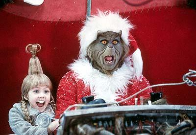 Little Cindy Lou-Who ( Taylor Momsen ) rides the sleigh with The Grinch ( Jim Carrey ) in Universal's Dr. Seuss' How The Grinch Stole Christmas