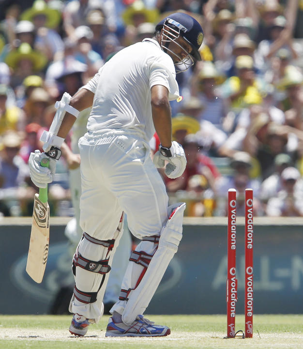 India's Rahul Dravid looks at his stumps after being bowled for 47 runs against Australia on the third day of their cricket test match at the WACA in Perth, Australia, Sunday, Jan. 15, 2012. Austr