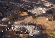 This aerial photograph taken on January 5, 2013, shows the devastation to property between Dunalley and Boomer Bay, in Tasmania, after bushfires swept through the area.