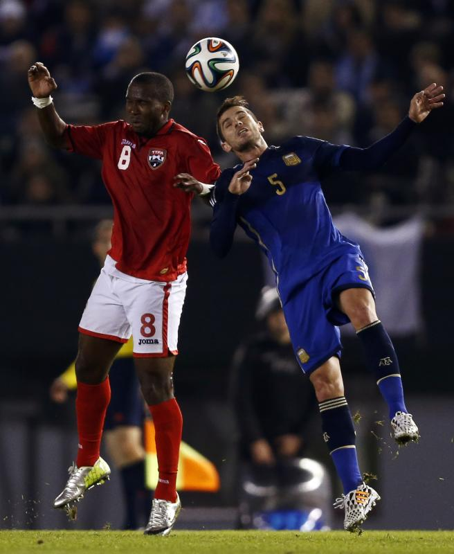 Argentina's Gago and Trinidad and Tobago's Hyland fight for the ball during their friendly soccer match in Buenos Aires