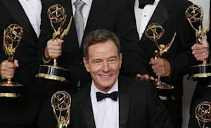 "Actor Bryan Cranston from AMC's series ""Breaking Bad"" poses backstage with his award for Outstanding Drama Series"