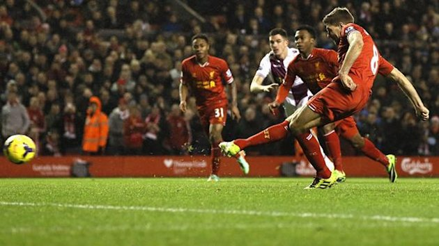 Liverpool's Steven Gerrard scores a penalty during their English Premier League match against Aston Villa at Anfield in Liverpool, January 18, 2014. REUTERS