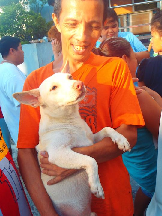 A pet owner from Malabon and his dog were among the recipients of  relief from the PAWS team