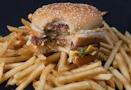 A partially eaten McDonald's Big Mac hamburger on top of some French fries on November 2, 2010. Thousands of workers at McDonald's and other fast food outlets across the United States went on strike Thursday in a growing movement for higher wages in the industry