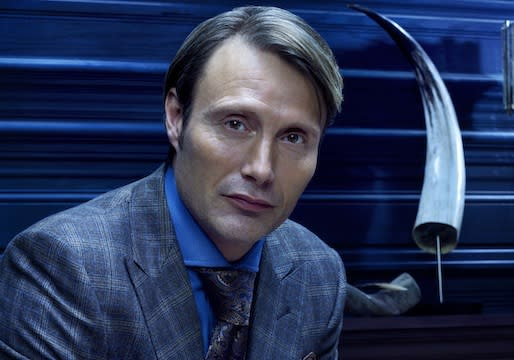 NBC's Hannibal (Finally) Gets a Premiere Date — Plus: A First Look at Dr. Lecter Poised to Pig Out