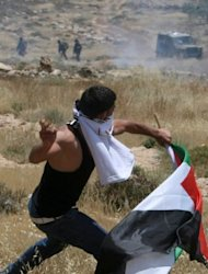 Palestinian protestors clash with Israeli forces following a demonstration against Israeli settlements in the West Bank village of Dair al-Hatab, east of Nablus in June 2011. Israel is willing to begin new Middle East peace talks using the 1967 lines as a basis for negotiations if the Palestinians drop their UN membership bid, an Israeli government official confirmed on Tuesday