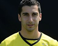 Borussia Dortmund midfielder Henrikh Mkhitaryan at the club's training ground in western Germany, on July 9, 2013. Dortmund expect to be without new signing Henrikh Mkhitaryan for the start of the new Bundesliga season on August 9 after the midfielder tore ankle ligaments