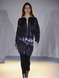 In this photo provided by Edun, a model walks the runway during the Edun Fall 2013 fashion show during Fashion Week, Thursday Feb. 8, 2013, in New York. (AP Photo/Edun, Sean Cunningham)