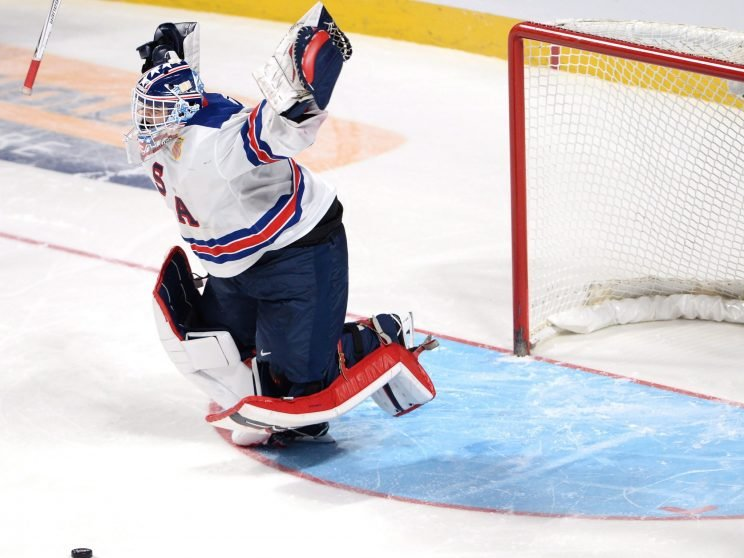 American goalie Tyler Parsons jumps for joy after the U.S. beat Canada 5-4 in a shootout to win world junior gold. (THE CANADIAN PRESS/Ryan Remiorz)