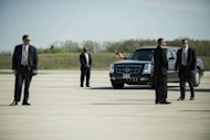 Members of the Secret Service await the arrival of US President Barack Obama at Detroit Metro Wayne County Airport in Detroit, Michigan. The US Secret Service said Wednesday that three employees will leave their jobs over the sex scandal in a hotel in Colombia which tarnished the elite presidential protection agency's image