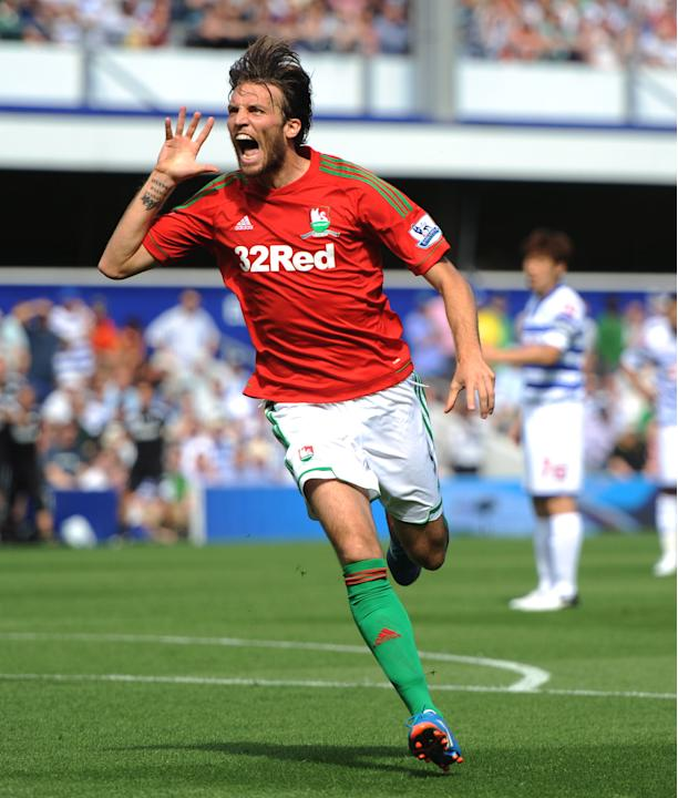 Michu's two goals helped Swansea to their first ever win at Loftus Road