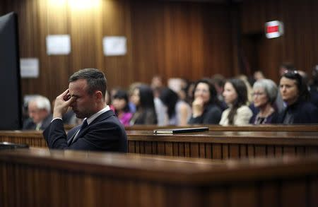 Oscar Pistorius reacts during his trial at North Gauteng High Court in Pretori