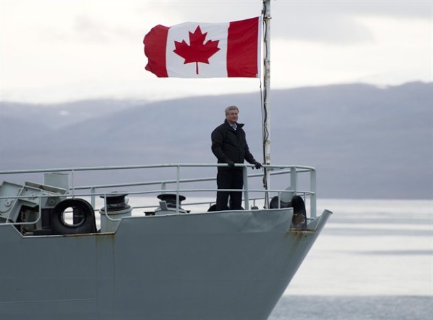 Canadian Prime Minister Stephen Harper stands on the bow of the HMCS Kingston on Sunday.