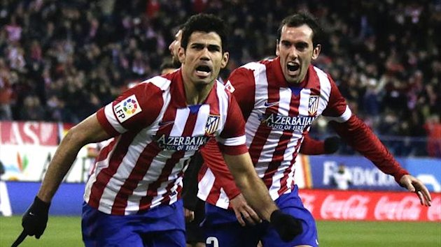 Atletico Madrid's Diego Costa celebrates his goal against Levante with teammate Diego Godin during their Spanish first division soccer match at Vicente Calderon stadium in Madrid December 21, 2013 (Reuters)