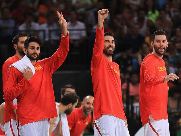 Ricky Rubio, Juan Carlos Navarro and Rudy Fernandez exult. (Getty Images)