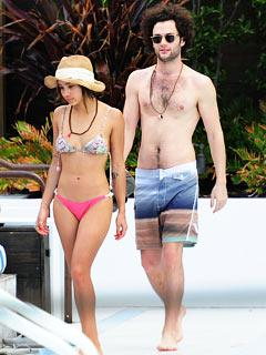 Bikini-Clad Zoe Kravitz Engages in Poolside PDA with Penn Badgley