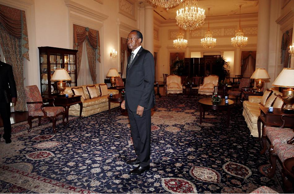 Burkina Faso's President Blaise Compaore waits in the East Drawing room of the Istana or presidential palace to meet with Singapore's Prime Minister Lee Hsien Loong Wednesday, April 23, 2014,