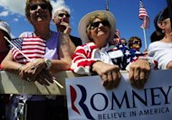 "Supporters of US presidential hopeful Mitt Romney attend a campaign rally at Scamman Farm in Stratham, New Hampshire. Romney kicked off a six-state bus tour Friday across what he called the ""backbone of America,"" as he seeks to cast himself as more in touch with struggling voters than President Barack Obama"