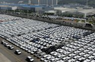 Rows of cars are seen parked for shipping in the southeastern port of Ulsan. South Korea's current account surplus in March rose to a four-month high thanks to robust auto and petrochemical exports, according to the central bank