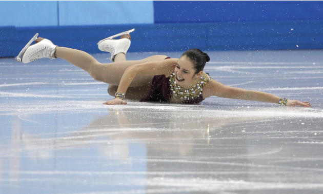 Kaetlyn Osmond of Canada falls as she competes in the women's team free skate figure skating competition at the Iceberg Skating Palace during the 2014 Winter Olympics, Sunday, Feb. 9, 2014, in Soc