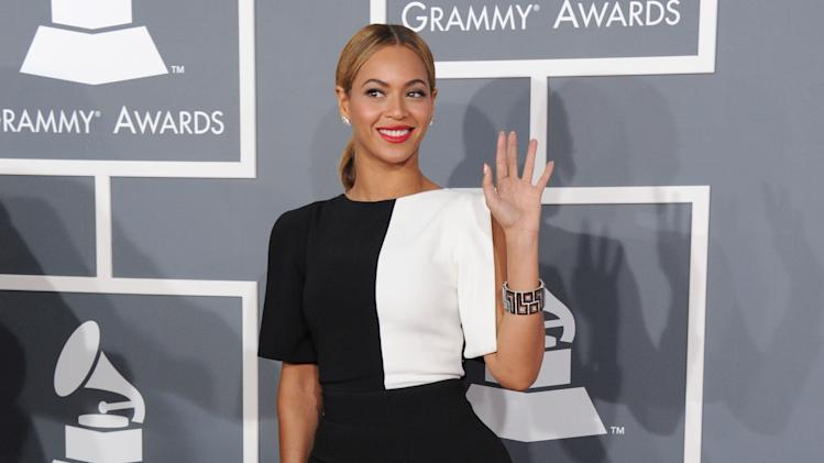FILE - This Feb. 10, 2013 file photo shows Beyonce at the 55th annual Grammy Awards in Los Angeles. Beyonce's fifth self-titled album, released in surprise form late last week, is collection of songs that highlight Beyonce's evolution as a woman and artist. (Photo by Jordan Strauss/Invision/AP, File)