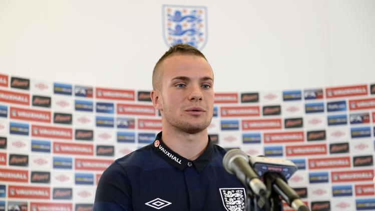 Tom Cleverley, pictured, believes Manchester United team-mate Wayne Rooney has what it takes to captain England regularly