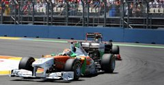 Force India and Renault compete