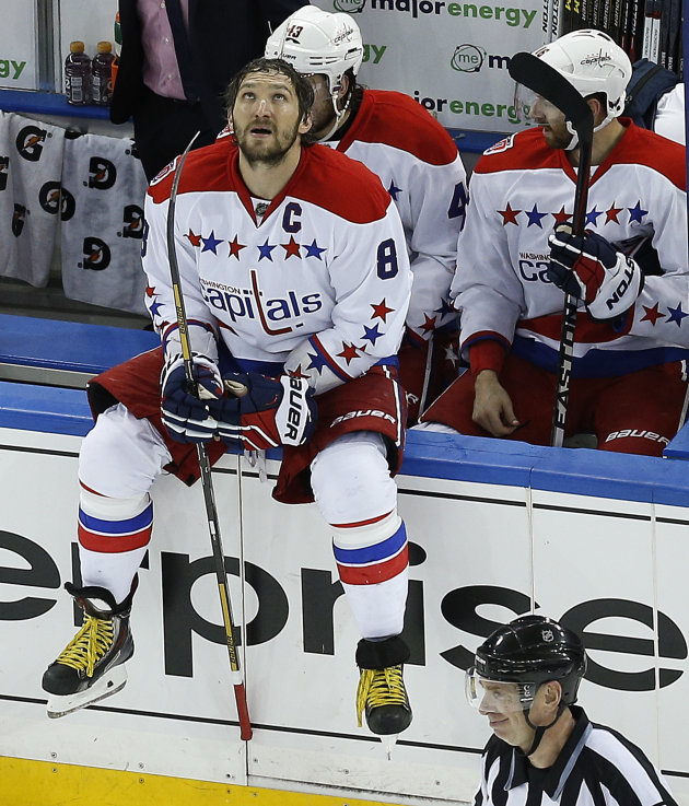Washington Capitals left wing Alex Ovechkin (8) takes break during a time out against the New York Rangers during the third period of Game 7 of the Eastern Conference semifinals during the NHL hockey Stanley Cup playoffs, Wednesday, May 13, 2015, in New York. (AP Photo/Julie Jacobson)