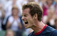 Britain's Andy Murray celebrates after defeating Cyprus' Marcos Baghdatis in the 3rd round men's singles tennis match at the All England Tennis Club in Wimbledon, southwest London, during the London 2012 Olympic Games