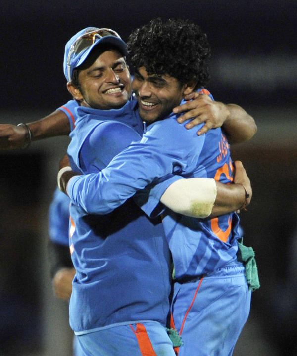 India's Ravindra Jadeja, right, celebrates with Suresh Raina after claiming the wicket of England's Tim Bresnan during their one day international cricket match at the Oval cricket ground, Lon
