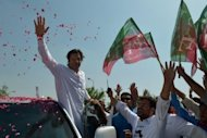 Pakistani cricketer turned politician Imran Khan waves to supporters at the start of a rally on the outskirts of Islamabad. Khan, who is campaigning before a general election next year, has made opposition to the drone programme a key plank of PTI policy. Critics accuse him of ignoring atrocities blamed on Islamist militants and abuses by the Pakistani army.