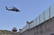 A Federal Police Black Hawk helicopter flies over the Tuxpan prison in Iguala, in the Mexican State of Guerrero January 3, 2014. REUTERS/Jesus Solano