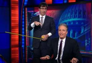 John Oliver and Jon Stewart | Photo Credits: Comedy Central
