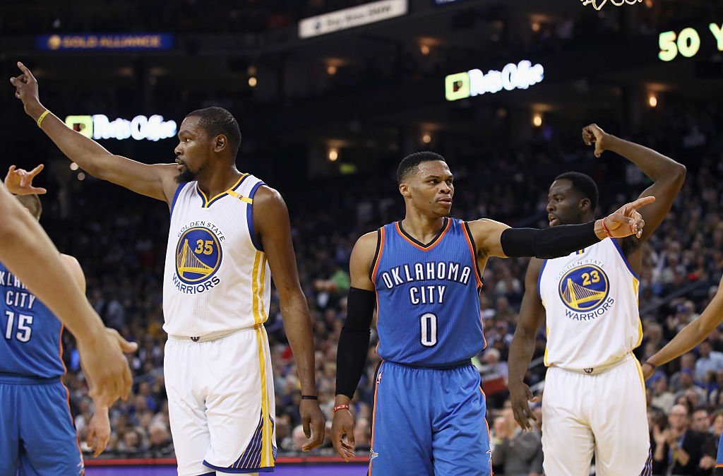 Kevin Durant and Russell Westbrook do their best not to talk. (Getty Images)