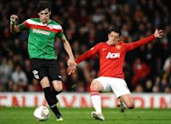 Athletic Bilbao's Spanish midfielder Javier Martínez (L) vies with Manchester United's Mexican forward Javier Hernández during a UEFA Europa League match between Manchester United and Athletico Bilbao at Old Trafford in March 2012. Bayern Munich chief Karl-Heinz Rummenigge hopes to sign Martinez from Athletic Bilbao before August's transfer window closes