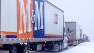 Traffic on Highway 104 was at a standstill after a handful of trucks got stuck in the snow.